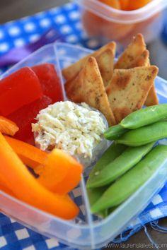 Jalapeño artichoke dip, crackers, sugar snap peas, orange bell pepper, and dried apricots