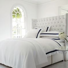 Stunning winged headboard with deep buttoned detail, softly curved to create a sense of intimacy