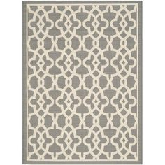 J&M: Add a pop of pattern to your living room or den with this hand-tufted wool rug, showcasing a geometric motif in grey.