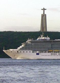 Costa Luminosa cruise ship near Christ the King Sanctuary in Lisbon