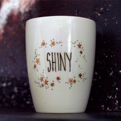 This 14oz mug is shiny indeed, with its pretty little gold and black stars. Perfect for any browncoat. Keep flyin.   *** If youd like a personalized