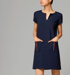 DRESS WITH LEATHER DETAILING