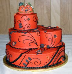 I really like this cake, except for the topper. I always dislike toppers, but this one takes a pretty cake in warm sunset orange with black swirls and blooms and forces it to be Halloween-y.