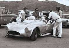 Before the 427 Cobra there was this prototype that was fitted with a 390 big block. This was taken at a test at Riverside.  Ken Miles in the black helmet,  He affectionately called the the car the turd,