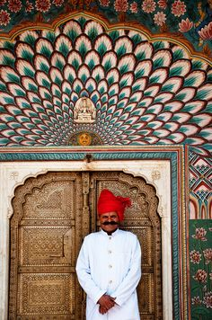 Pride of Rajasthan -- City Palace, Jaipur, India look beautiful peacock feather inspired painting over golden doorway and lotus mural on the side!! .... INDIAN Peacock?