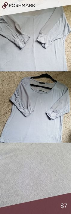 Sheer detail top Light grey 3/4 sleeves. Sheer across back shoulder and down the sleeves. Very cute. Some signs of wear barley noticable. See last picture. B'leev Tops Blouses