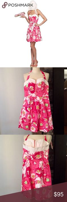 Lilly Pulitzer  Marisa Dress Pique A sundress that's equal parts modern and retro and totally fabulous! Bundle with Lilly shoes in my closet for the perfect outfit!  Halter dress in vintage cotton pique. Bright and lush begonia print. Ties at the neck. Solid trim on the bodice and back. Sweetheart neckline. Fitted corset-style bodice. Exposed zip front. Pleated full skirt. Side seam hand pockets. Lined. Shell & Lining: 100% cotton Lilly Pulitzer Dresses