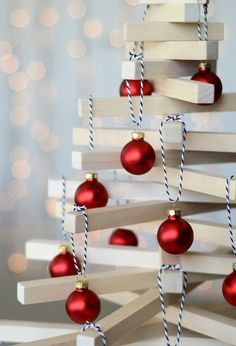 """DIY wooden tabletop Christmas tree. Instead of balls hang other decoration. Could also do a """"natural"""" version made from tree branches."""
