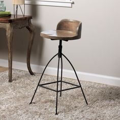 Rustic meets industrial in this unique hand-crafted counter stool. The solid mango wood seat features a round construction with a low-profile back support, composed atop a sturdy metal frame with an adjustable height. #diningroomfurniture