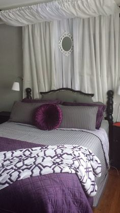 Grey, purple, black, and white master bedroom. Wall lamps from and rast side tables from ikea