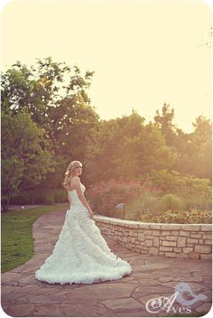 Pretty light rim lighting bridal with rosette dress and hair halfway up bridals