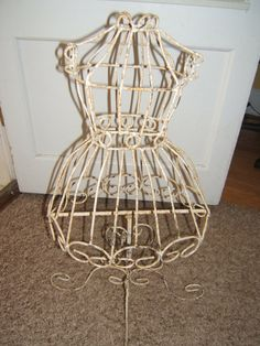 Metal dress form. I have one of these. Now to decide what to do with it:)