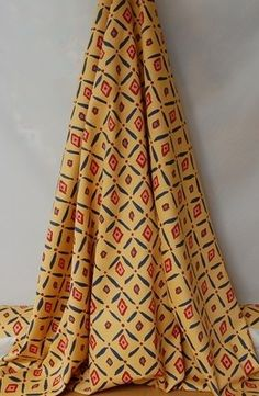'Villamoura' by Select Textiles 100% cotton fabric, orange, blue and red £3 per metre