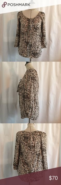 Rebecca Taylor animal print blouse Cute Rebecca Taylor animal print blouse! Retails for $250!! 100% rayon. Great condition. Rebecca Taylor Tops Blouses