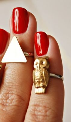 gold owl ring, triangle ring, red nails