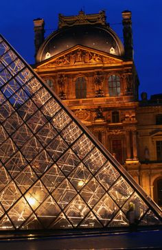 'In the courtyard of the Louvre in Paris is the 66ft tall glass pyramid.' by Lonely Planet Images