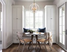 Interior Design Ideas Great way to combine a dining area and the bonus of all that extra storage.
