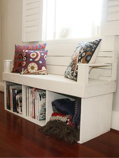 DIY storage bench - turn cheap bookcase on its side, add an upholstered cushion for bench seat and there ya go!
