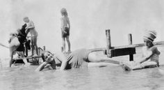 Anna Lipke Caine (foreground, lying in water) with her niece (right) at Oneida Lake, NY, 1931.