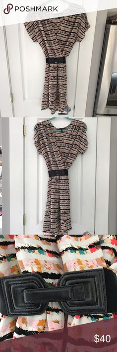 """BCBG Max Azria Parfait Faux Wrap Belted Silk Dress This is the perfect spring/summer dress! 100% Silk. Faux wrap style dress with no defects, excellent used condition. Elastic waist. Comes with a 2"""" wide elastic, black leather hook closure belt. Elastic rusched shoulders w/shoulder slits. Shoulder seam to hem 34"""", waist to hem 18"""". Great multi-color print. Pair this dress with block heels or flat sandals for a stylish but effortless look. BCBGMaxAzria Dresses"""