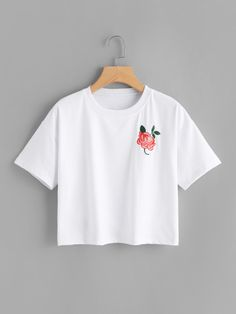 Camiseta floral con bordado de hombros caídos