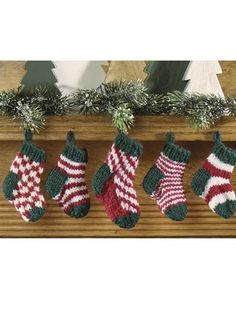 I want these!!! We never do much for stocking stuffers, since the kids don't need a ton of candy. These would be perfect and way cute!! Mini Christmas Stocking Set - Knit