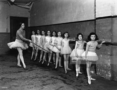 Russian ballet dancer Tamara Karsavina (1885 - 1978) with young pupils at her dancing studio.