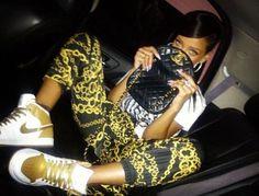 Rihanna wearing Air Jordan 1 Gold
