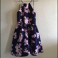 Orchid Print Fit Backless Dress Backless Orchid print fit and flare short dress. Only worn only once. In good conditions. Perfect for all special occasions. L'atiste Dresses Backless