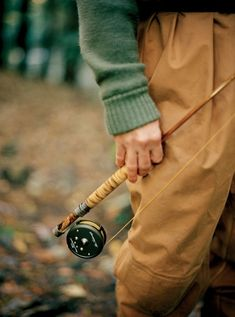 Vintage bamboo fly rod. Wool sweater. Tan waders. Fly fishing in autumn/fall