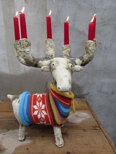 Ceramic moose candelabra in a hand knitted sweater with Norwegian star pattern