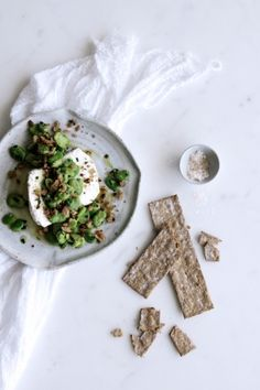 fresh ricotta with broad beans & rye sourdough breadcrumbs