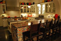 Love love love the multi coloured Spanish tile kitchen countertop in The New Normal