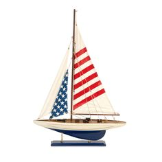 This attractive replica sailboat is a lovely way to show your patriotism and your love of the ocean. The sails feature the stars and stripes of the American flag, while small details like rigging and railings add an authentic feel.