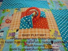 baby play mat twists.....put twists in corners for toys