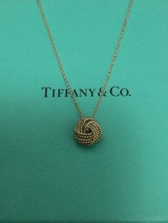 Tiffany & Co Twisted Knot Pendant On 16 In Silver Chain. Get the lowest price on Tiffany & Co Twisted Knot Pendant On 16 In Silver Chain and other fabulous designer clothing and accessories! Shop Tradesy now