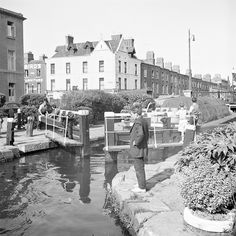 Some boys having a fine time inspecting proceedings as a barge makes its way through a lock on the Grand Canal at Portobello, Dublin. barge, serial no. Photographer: Elinor Wiltshire Date: Summer 1959 NLI Ref. Dublin Map, Dublin Hotels, Visit Dublin, Dublin City, Dublin Ireland, Ireland Pictures, Old Pictures, Old Photos, Vintage Photos