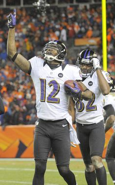 Ravens wide receiver Jacoby Jones celebrates after scoring a 70-yard touchdown in the final minute of regulation against the Denver Broncos.