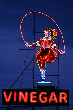 Little Audrey The heritage-listed Skipping Girl Vinegar neon sign in the Melbourne suburb of Abbotsford, Victoria, Australia. Old Neon Signs, Vintage Neon Signs, Old Signs, Roadside Attractions, Roadside Signs, Look Vintage, Googie, Advertising Signs, Neon Lighting