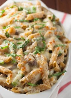 Penne pasta with mushrooms and asparagus are flavored with lemon and basil and wrapped in creamy ricotta cheese. | realfoodandicecream.com