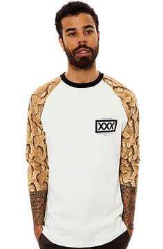 The 10 Deep Bullpen Baseball Tee in Snake This 10 Deep shirt is not your typical baseball tee. It features stylish contrast sleeves with snakeskin print, a solid black neckline and contrast logo graphic at left chest. For the full effect, check out our complete selection of 10 Deep apparel and gear. 3/4 length sleeves Contrast black neckline Contrast logo graphic at left chest Small contrast logo tag at right side above hem 100% cotton Machine wash cold Imported By 10 Deep