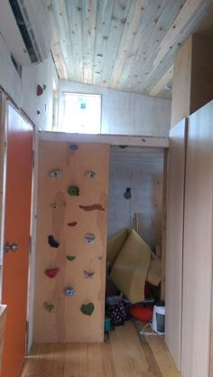 Rob Irwin built this small home, which comes with a mini rock climbing wall.