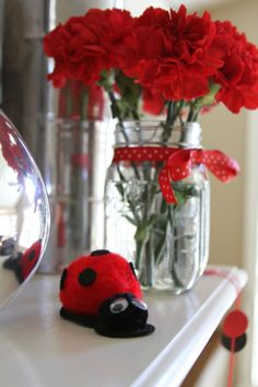Ladybug Birthday Party Decor    Pom-Pom ladybugs with googly eyes.. perfect little craft to do with toddlers and kids
