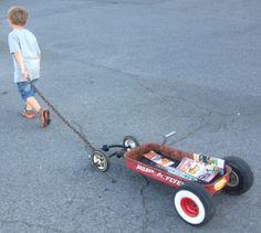 My son pulling his wagon at rod run