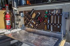 camp essentials Build This DIY Tailgate Table and Utensil Holder for Your Next Camping Trip Tailgate Table, Camping Table, Camping Ideas, Camping Hacks, Picnic Ideas, Jeep Camping, Jeep Wrangler Camping, Camping Box, Camping Trailers