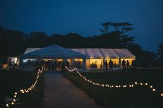 Wedding marquee with fairy light pathway leading the way to the celebrations!