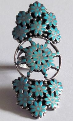 Ring   Roosevelt & Bernice Tekala (Zuni).  Sterling silver and turquoise.