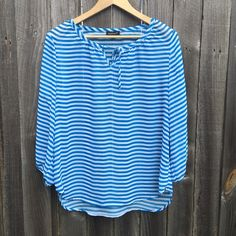 """Turquoise Blue & White Stripped Boho Blouse Turquoise Blue & White Stripped Boho Blouse. NWT! Great shape! Semi sheer polyester. Very flowy and loose fitting. Tied at collar. Elastic on sleeves. Bust 38"""", hips 44"""", length 26"""" #gypsy, #soho, #peasant, #hippie, #nautical, #coachella Womyn Tops Tunics"""