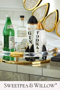 Send spirits into orbit with this stylish, retro-rad black and 24-karat gold porcelain decanter. Embellished with a bold suggestion of what's stashed inside, serve your guests an out-of-this-world cocktail experience. #sweetpeaandwillow #jonathanadler #decanter #retroaccessories #artdeco Sutton House, Sweetpea And Willow, Circle Bar, Tv Entertainment Units, Gold Furniture, Gold Home Decor, Convex Mirror, Modern Art Deco, Jonathan Adler