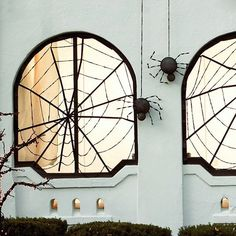 black tape spider web on window for halloween decoration